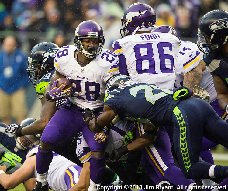 Minnesota Vikings running back Adrian Peterson looks for running room against the  at CenturyLink Field in Seattle, Washington on  November 17, 2013.  The Seahawks beat the Vikings 41-20.  ©2013.  Jim Bryant. All Rights Reserved.