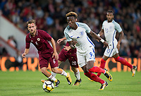 Tammy Abraham (Swansea City (on loan from Chelsea) of England U21 heads past Kriss Karklins (Liepaja) of Latvia U21 during the UEFA EURO U-21 First qualifying round International match between England 21 and Latvia U21 at the Goldsands Stadium, Bournemouth, England on 5 September 2017. Photo by Andy Rowland.