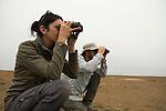 Snowy Plover (Charadrius nivosus) biologists, Karine Tokatlian and Ben Pearl, observing parents at nest in salt pond, Eden Landing Ecological Reserve, Union City, Bay Area, California