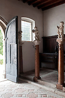 The floor of the stables is a mixture of local red and white stone which has been indented to assist the horses' stability and each stall is heralded by a cherub on a marble column