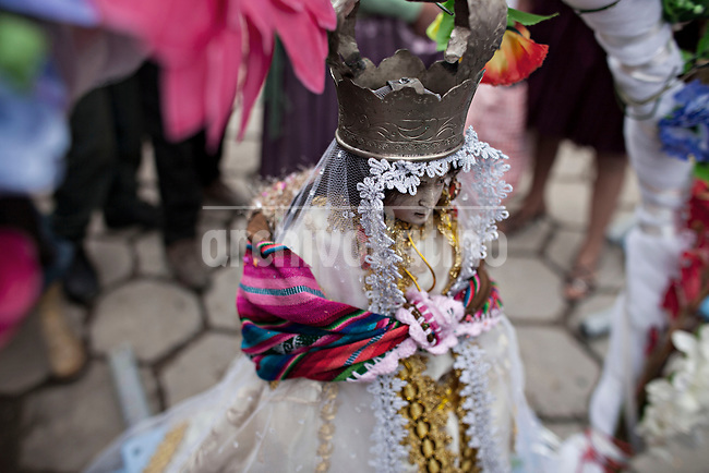 A picture dated Saturday January 26, 2013 shows an image of a Virgin at the Miners Carnival in the Andes city of Potosi in Bolivia.  Already in 1663 the Spanish chronicler Marquez Jerez de los Caballeros described the colorful  miners carnival in Potosi. Four centuries later, the tradition of the legendary Cerro Rico miners is  still alive ..