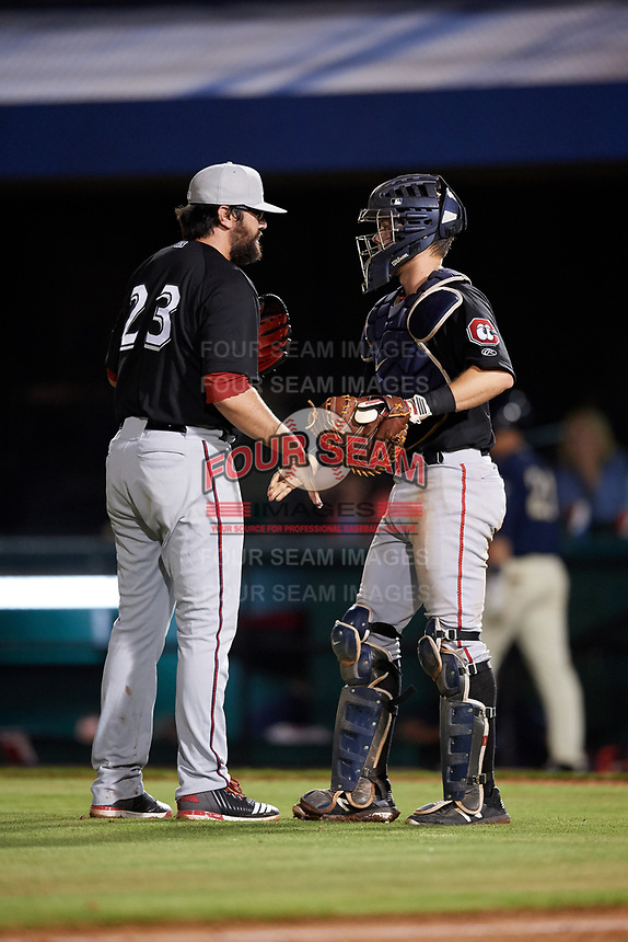 Chattanooga Lookouts relief pitcher Todd Van Steensel (23) meets with catcher Brian Olson (30) in front of the mound during a game against the Mobile BayBears on May 5, 2018 at Hank Aaron Stadium in Mobile, Alabama.  Chattanooga defeated Mobile 11-5.  (Mike Janes/Four Seam Images)