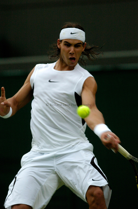 Photo: Richard Lane..Wimbledon Championships. 27/06/2006. .Spain's Raphael Nadal returns during his 1st round match.