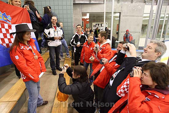Salt Lake City - Croatian fans and athletes celebrate a bronze medal win by skiier Rea Hraski. Medals Ceremony, 2007 Winter Deaflympics, at the Steiner Ice Arena.