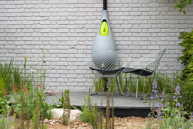Climate Calm Garden, Nicholas Dexter, RHS Chelsea Flower Show 2012. A wall-mounted water butt for collecting rainwater, with built-in self-filling watering can.