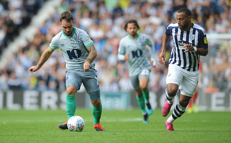 Blackburn Rovers' Adam Armstrong under pressure from West Bromwich Albion's Matt Phillips<br /> <br /> Photographer Kevin Barnes/CameraSport<br /> <br /> The EFL Sky Bet Championship - West Bromwich Albion v Blackburn Rovers - Saturday 31st August 2019 - The Hawthorns - West Bromwich<br /> <br /> World Copyright © 2019 CameraSport. All rights reserved. 43 Linden Ave. Countesthorpe. Leicester. England. LE8 5PG - Tel: +44 (0) 116 277 4147 - admin@camerasport.com - www.camerasport.com