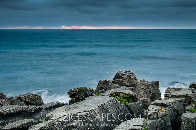 Stormy, dramatic skies in Punakaiki at pancake rocks, Paparoa National Park, Buller Region, West Coast, New Zealand, NZ