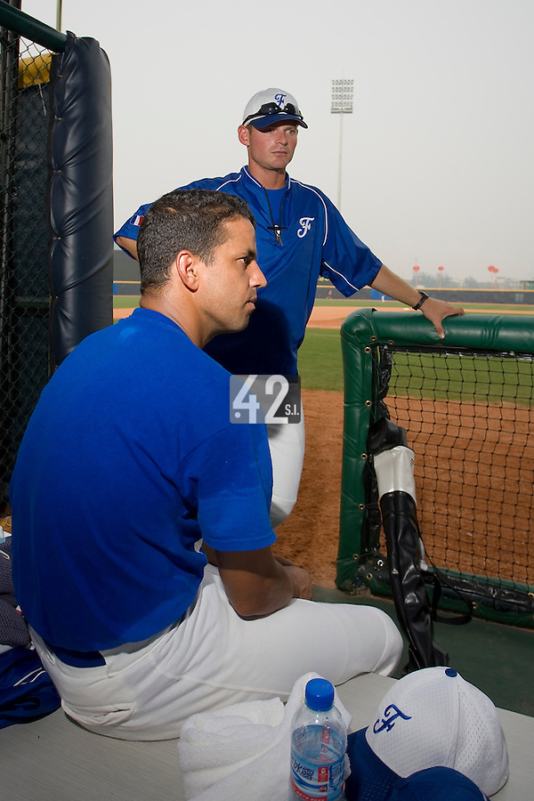 20 August 2007: Jamel Boutagra and team manager Jeff Zeilstra (behind) rests in the dugout prior to the Czech Republic 6-1 victory over France in the Good Luck Beijing International baseball tournament (olympic test event) at the Wukesong Baseball Field in Beijing, China.