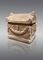 Roman relief decorated garland osthotek cremation container, 2nd century AD. An ostothec is used to preserve the ashes and bones of the dead bodies after their cremation, takes its form from a small sarcophagus. This ostothec is a miniature example of the garland sarcophagus. Adana Archaeology Museum, Turkey. Against a grey background