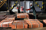 MUFULIRA, ZAMBIA- JULY 6: Workers move batches of copper sheets, which are stored in a warehouse and wait to be loaded on trucks on July 6, 2016 in Mufulira, Zambia. The copper is trucked to ports such as Dar es Salaam, Tanzania & Durban, South Africa. Glencore, an Anglo-Swiss multinational commodity trading and mining company. owns about 73 % of Mopani mines, which produces copper and some cobalt. The mine employs about 15,000 people. Many people in the area are dependent on the mines and its subcontractors for work. (Photo by Per-Anders Pettersson)
