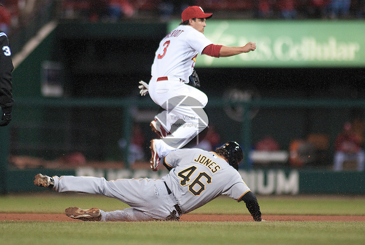 4 April 2011                              St. Louis Cardinals shortstop Ryan Theriot (3) jumps over Pittsburgh Pirates first baseman Garrett Jones (46) for the double play throw to first. The Pittsburgh PIrates beat the St. Louis Cardinals 4-3 in the first game of a three-game series on Monday April 4, 2011 at Busch Stadium in downtown St. Louis.