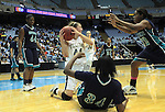 Bishop McGuinness' Cameron Nieters secures a loose ball between a host of Southside High School defenders during the Villains' 60-44 win, a 7th-consecutive state title and a new state record, at the Dean Smith Center in Chapel Hill, NC, on Saturday, March 10, 2012.  Photo by Ted Richardson
