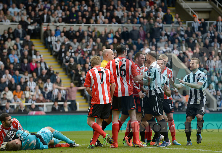 A melee breaks between the Sunderland and Newcastle players after Simon Mignolet of Sunderland (L) goes down injured after a collision with Steven Taylor of Newcastle United - Barclays Premier League - Newcastle Utd vs Sunderland - St. James' Park - Newcastle - 14/04/13 - Picture Richard Lee/Sportimage