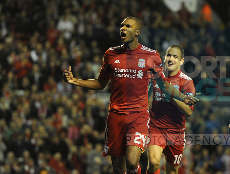 David N'Gog of Liverpool celebrates scoring from the penalty spot with Joe Cole of Liverpool