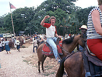 Photographer Brian Cleary , on horseback, prepares to head up the mountain to the ruins of the Citadelle Henri Christophe near Cap-Haïtien, Haiti, 1981.  (Photo by Brian Cleary/www.bcpix.com)