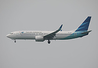 A Garuda Indonesia Boeing 737-8U3 Registration PK-GMU landing on Runway 25R at Hong Kong Chek Lap Kok International Airport on 6.4.19 arriving from Denpasar Ngurah Rai International Airport, Indonesia.