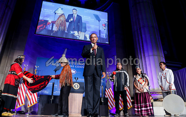 US President Barack Obama receives a traditional blanket and hat during a blanketing ceremony at the 2016 White House Tribal Nations Conference at the Andrew W. Mellon Auditorium, September 26, 2016, Washington, DC. The conference provides tribal leaders with opportunity to interact directly with federal government officials and members of the White House Council on Native American Affairs. Photo Credit: Aude Guerrucci/CNP/AdMedia