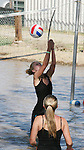Corbi Friberg hits the ball over the net during mud volleyball at the 2008 Cantaloupe  Festival.  Photo by Tom Smedes.