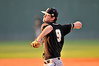 Relief pitcher Will Stillman (9) of the Wofford Terriers delivers a pitch in a SoCon Tournament game against Western Carolina on Wednesday, May 25, 2016, at Fluor Field at the West End in Greenville, South Carolina. Western won, 10-9. (Tom Priddy/Four Seam Images)