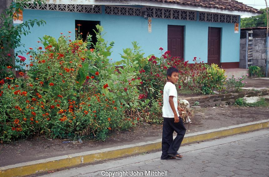 Boy walking down a street in the town of Altagracia on Isla de Ometepe, Nicaragua