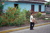 Boy walking down a street in the town of Altagracia on Isla de Ometepe, Nicaragua