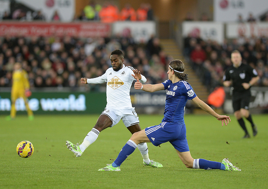 Swansea City's Nathan Dyer vies for possession with Chelsea's Filipe Luis<br /> <br /> Photographer /Ashley CrowdenCameraSport<br /> <br /> Football - Barclays Premiership - Swansea City v Chelsea - Saturday 17th January 2015 - Liberty Stadium - Swansea<br /> <br /> &copy; CameraSport - 43 Linden Ave. Countesthorpe. Leicester. England. LE8 5PG - Tel: +44 (0) 116 277 4147 - admin@camerasport.com - www.camerasport.com