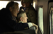United States Secretary of Defense Donald H. Rumsfeld and Chairman of the Joint Chiefs of Staff General Richard Myers look at the Abu Ghraib Detention Center while doing a windshield tour of the facility on May 13, 2004.  Rumsfeld and Myers are in Iraqi to visit the troops in Baghdad and Abu Ghraib.  <br /> Mandatory Credit: Jerry Morrison / DoD via CNP