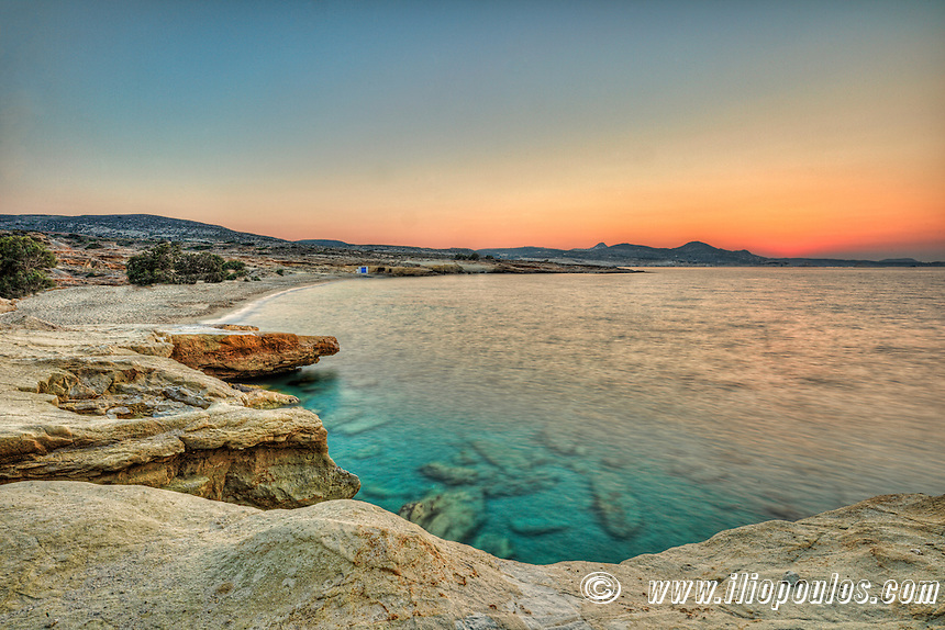 Sunset at the beach of Mitakas in Milos, Greece
