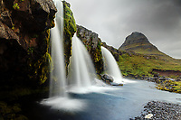 The Kirkjufellsa River flows over Kirkjfellsfoss below Kirkjufell (Church Mountain), Grundarfjordur, Snaefellsnes peninsula, West Iceland, Iceland