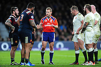 Referee Angus Gardner speaks to both sets of front rows during a break in play. RBS Six Nations match between England and France on February 4, 2017 at Twickenham Stadium in London, England. Photo by: Patrick Khachfe / Onside Images