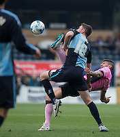 Danny Rowe of Wycombe Wanderers manhandles Marc Richards of Northampton Town off the ball during the Sky Bet League 2 match between Wycombe Wanderers and Northampton Town at Adams Park, High Wycombe, England on 3 October 2015. Photo by Andy Rowland.