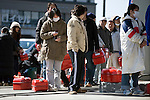 Residents line up for hours to fill their tanks with gas in Sendai, Japan on 19 March, 2011.  Photographer: Robert Gilhooly