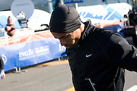 Meb Keflezighi stretching before the start of the Men's elite runners at the ING New York City Marathon on Staten Island on 07 November 2010.
