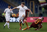 Calcio, Serie A: Roma vs Milan. Roma, stadio Olimpico, 12 dicembre 2016.<br /> Milan's Ignazio Abate, left, is challenged by Roma&rsquo;s Emerson Palmieri during the Italian Serie A football match between Roma and AC Milan at Rome's Olympic stadium, 12 December 2016.<br /> UPDATE IMAGES PRESS/Isabella Bonotto