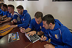 Members of the Mansfield Town first-team squad signing autographs for fans in the Sandy Pate Lounge at Field Mill stadium during an open day held for the club's supporters. Mansfield Town achieved promotion back to England's Football League by winning the Conference National in season 2012-13. Field Mill was the oldest ground in the Football League, hosting football since 1861 although some reports date it back as far as 1850, with Mansfield Town having played there since 1919.