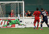 WASHINGTON, DC - July 28, 2012:  Bill Hamid (28) of DC United makes a save on Zlatan Ibrahimovic (18) of PSG (Paris Saint-Germain) in an international friendly match at RFK Stadium in Washington DC on July 28. The game ended in a 1-1 tie.