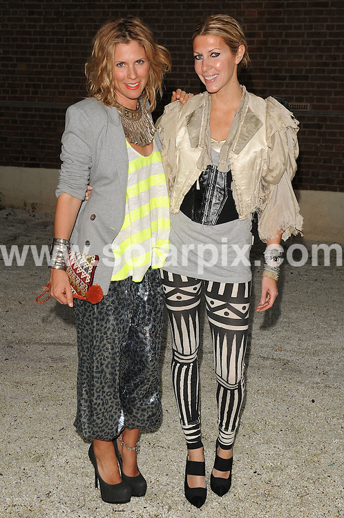 **ALL ROUND PICTURES FROM SOLARPIX.COM**.**WORLDWIDE SYNDICATION RIGHTS**.Sass and Bide warehouse party arrivals, Alexandria, London, UK. 23 July 2009..This pic: Sarah-Jane Clarke and Heidi Middleton..JOB REF: 9592  SSD     DATE: 23_09_2009.**MUST CREDIT SOLARPIX.COM OR DOUBLE FEE WILL BE CHARGED**.**MUST NOTIFY SOLARPIX OF ONLINE USAGE**.**CALL US ON: +34 952 811 768 or LOW RATE FROM UK 0844 617 7637**