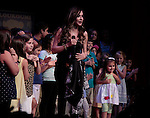 Singer Anna Vissi sings with children and Malena (R) (daughter of Constantine Maroulis) at Loukoumi & Friends Concert held on June 23, 2014 at the Scholastic Theatre, New York City, New York.  Proceeds will benefit The Loukoumi Make a Difference Foundation. Foundation first project will be the Make A Difference with Loukoumi television special airing on FOX stations Oct 19-20. (Photo by Sue Coflin/Max Photos)