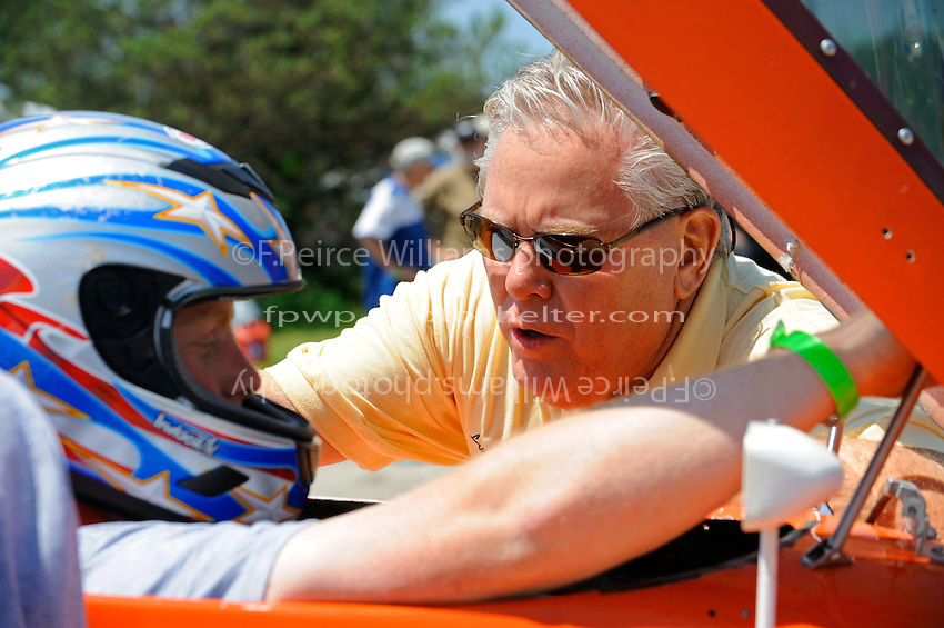 Pastor Laurie Vidal prays with a racer.