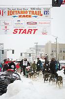 Kirk Barnum leaves the 2011 Iditarod ceremonial start line in downtown Anchorage, during the 2012 Iditarod..Jim R. Kohl/Iditarodphotos.com
