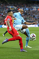 Nathaniel Clyne of Liverpool and Vincent Kompany of Manchester City battle for the ball during the Capital One Cup match between Liverpool and Manchester City at Wembley Stadium, London, England on 28 February 2016. Photo by David Horn / PRiME Media Images.