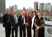 French actress Emanuelle Bear (4th from Left)  who is the President of the 25th  World Film Festival's  Jury pose with Montreal Cinema Commissary : Andre Lafond (3rd from left) and some other members of the Jury at  a reception at Montreal City Hall, august 29th , 200l in Montreal, CANADA.<br /> <br /> Brought up on a farm in Provence because her father, French singer and poet Guy B&Egrave;art didn't want her to be affected by the glamour world of Paris showbusiness, Emmanuelle B&Egrave;art nevertheless got the acting urge in early adolescence. At age 15, after a couple of bit parts, she came to Montreal as an au pair to learn English. Back in France, after acting lessons and few small roles in television, she made her big-screen breakthrough in the title role of Claude Berri's Pagnol adaptation, MANON OF THE SPRING (1986). A year later she made her Hollywood debut in Tom McLoughlin's DATE WITH AN ANGEL. She has since played for some of the premier directors on both sides of the Atlantic: Rivette (LA BELLE NOISEUSE, 1991), Sautet (NELLY AND MR. ARNAUD (1995), Chabrol (L'ENFER,1994), De Palma (MISSION: IMPOSSIBLE, 1996) and Ruiz (TIME REGAINED, 1999). She stars in Catherine Corsini's REPLAY, showing at this year's Festival.<br /> <br /> <br /> Photo by John Raudsepp / Getty Images<br /> (ON SPEC- Scanned &amp; Transmitted  by &amp; Payable to<br /> Pierre Roussel)<br /> <br /> NOTE : 35mm film scan
