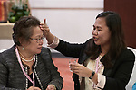 Jennifer Meneses anoints the forehead of the Rev. Marie Sol Villalon with oil on January 17, 2018, during an international gathering of United Methodist Women in Manila. Meneses is executive secretary  of the Board of Women's Work of the Philippines Central Conference. Villalon is a pastor to victims of human trafficking.