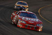 Apr 22, 2006; Phoenix, AZ, USA; Nascar Nextel Cup driver Dale Earnhardt Jr. of the (8) Budweiser Chevrolet Monte Carlo leads Matt Kenseth during the Subway Fresh 500 at Phoenix International Raceway. Mandatory Credit: Mark J. Rebilas-US PRESSWIRE Copyright © 2006 Mark J. Rebilas..