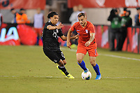 EAST RUTHERFORD, NJ - SEPTEMBER 7: Jordan Morris #11 of the United States battles for the ball with Erick Gutierrez #25 of Mexico during a game between Mexico and USMNT at MetLife Stadium on September 6, 2019 in East Rutherford, New Jersey.