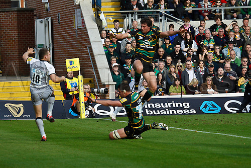 30.10.2010 Aviva Premiership Rugby Northampton Saints v Newcastle Falcons.  Newcastle's Jimmy Gopperth clears from his own in goal area as Northamption's Jon Clarke (upper) and Calum Clarke (lower) close in.