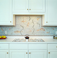 Sealife hand-chopped tumbled stone mosaic backsplash.
