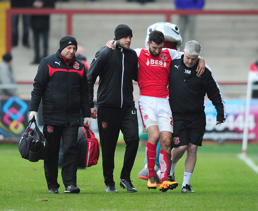 Fleetwood Town's Conor McLaughlin is helped off the pitch after suffering an injury<br /> <br /> Photographer Chris Vaughan/CameraSport<br /> <br /> Football - The Football League Sky Bet League One - Fleetwood Town v Scunthorpe United  - Saturday 20th February 2016 - Highbury Stadium - Fleetwood    <br /> <br /> &copy; CameraSport - 43 Linden Ave. Countesthorpe. Leicester. England. LE8 5PG - Tel: +44 (0) 116 277 4147 - admin@camerasport.com - www.camerasport.com