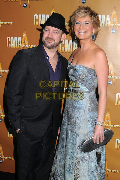 SUGARLAND - Kristian Bush & Jennifer Nettles .44th Annual CMA Awards, Country Music's Biggest Night, held at Bridgestone Arena, Nashville, Tennessee, USA, 10th November 2010..CMAs country music Half length grey gray purple shirt black hat suit strapless grey gray blue print dress clutch bag .CAP/ADM/LF.©Laura Farr/AdMedia/Capital Pictures.