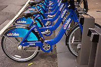Bikes are lined up in their docking station in the Tribeca neighborhood in New York on Sunday, May 26, 2013 in anticipation of the Monday roll-out of the city's bike-sharing program. 6000 bikes in over 300 stations await subscribers to the program. (© Richard B. Levine)